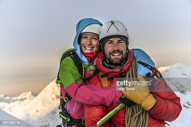 Couple watch the sunrise in the Austrian Alps