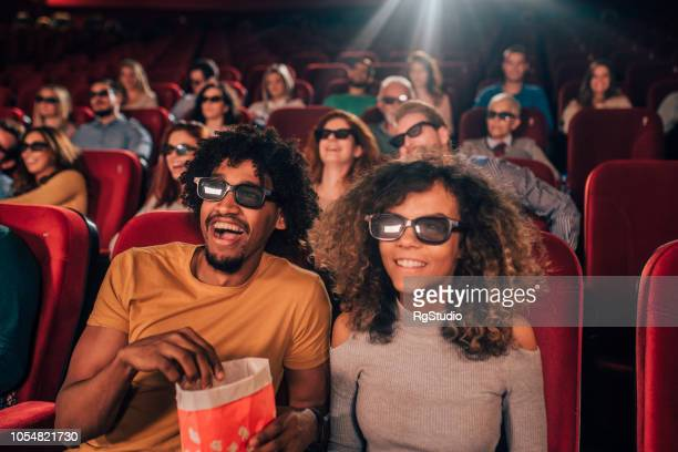 couple watching 3d movie at cinema - comedy film stock photos and pictures
