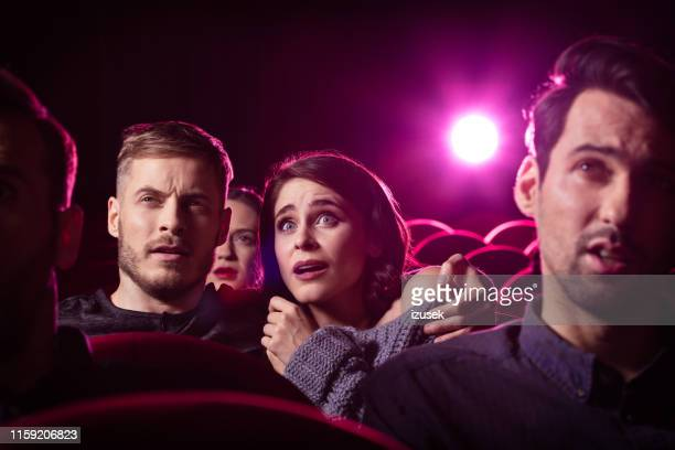 couple watching a horror movie at theater - film screening stock pictures, royalty-free photos & images