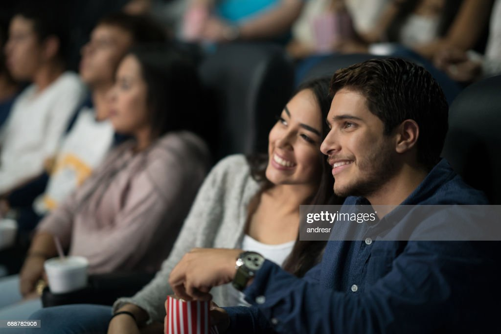 Couple watching a movie at the cinema : Stock Photo