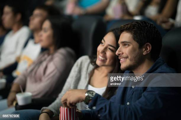 Couple watching a movie at the cinema