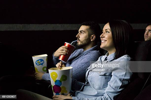 Couple watching a movie in a cinema