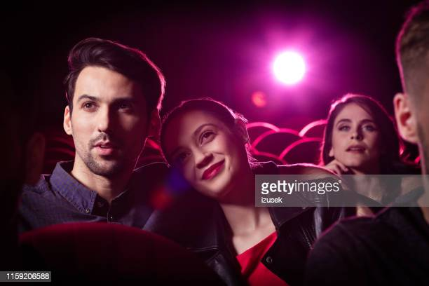 couple watching a romantic movie in theater - film screening stock pictures, royalty-free photos & images