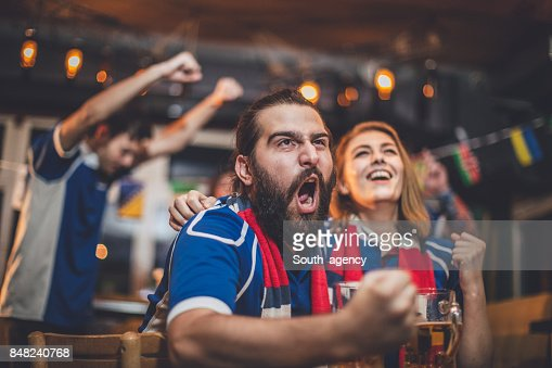 Couple watching game in pub