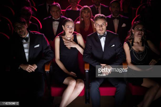 couple watching horror movie in theater - opera stock pictures, royalty-free photos & images