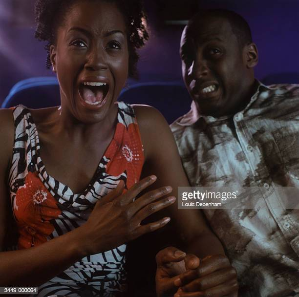 couple watching horror movie - horror movie stock photos and pictures