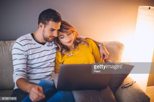 Couple watching romantic movie on laptop