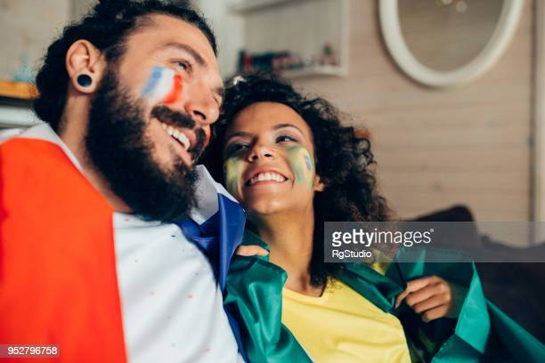 Couple watching soccer game on TV