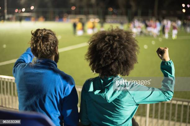 Couple watching soccer game