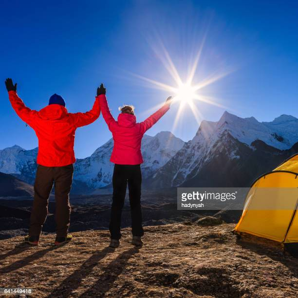 Couple watching sunrise in Himalayas, Mount Everest National Park