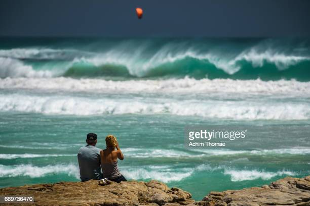 couple watching the waves near cape town, south africa - landschaft stock pictures, royalty-free photos & images