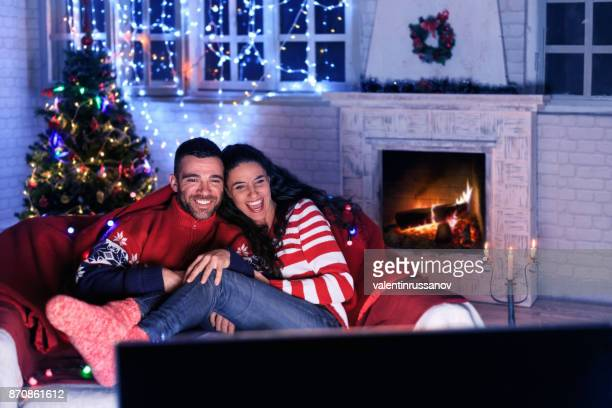 couple watching tv at home - film stock pictures, royalty-free photos & images