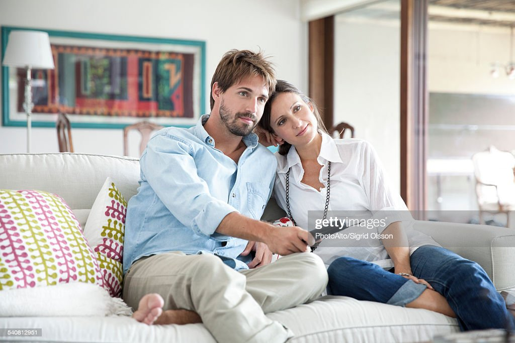 Couple watching TV together : Stock Photo