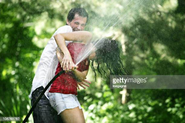 Couple water fighting