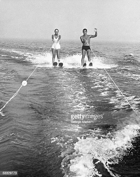 Couple water skiing