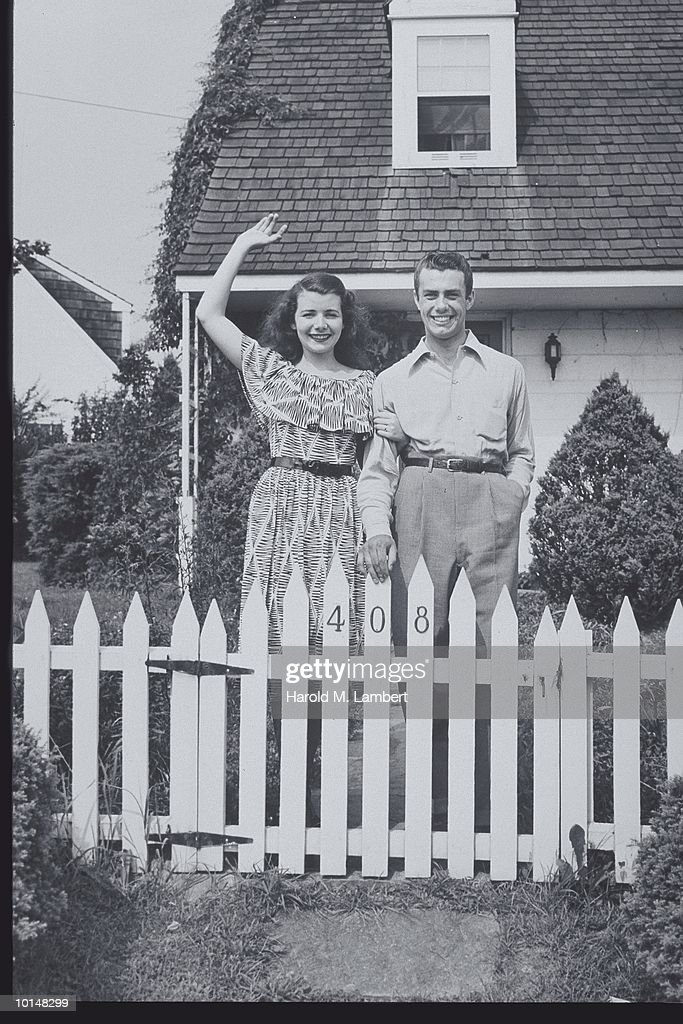 Couple Waves By White Picket Fence 1947 The American Dream Stock