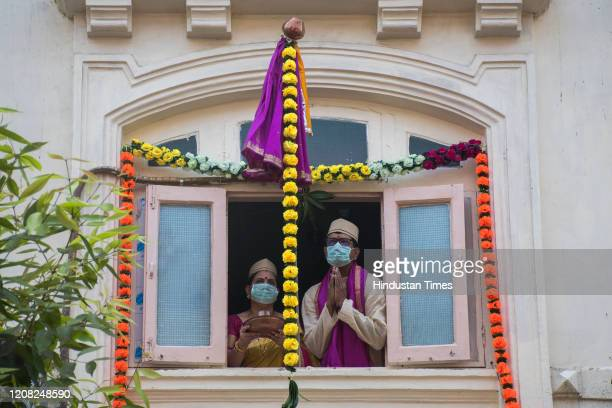 Couple wear mask along with traditional attire offer prayers as they celebrate Gudi Padwa at Girgaon, on March 25, 2020 in Mumbai, India. Prime...