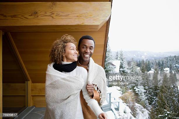 couple wearing a blanket - log cabin stock pictures, royalty-free photos & images