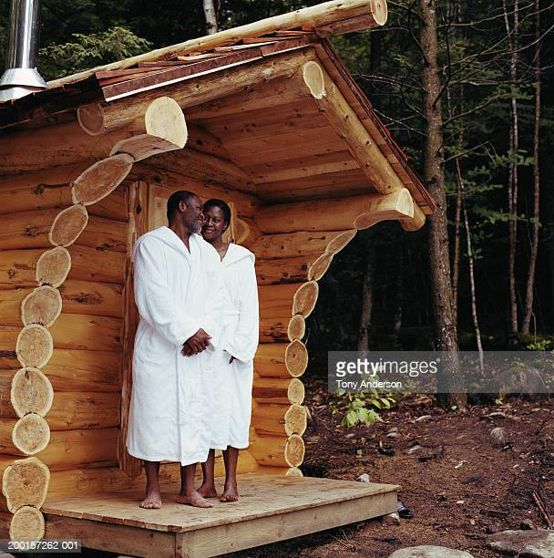 couple wearing bathrobes outside sauna - black woman in sauna stock pictures, royalty-free photos & images