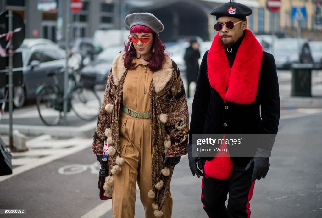 A couple wearing beret is seen outside Represent during Milan Men's Fashion Week Fall/Winter 2018/19 on January 15, 2018 in Milan, Italy.