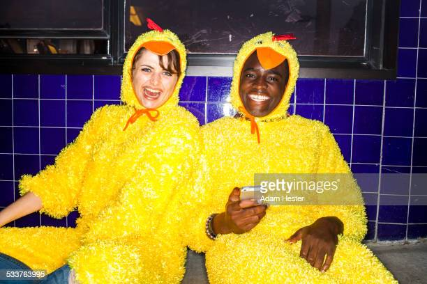 couple wearing chicken costumes indoors - funny rooster stock photos and pictures
