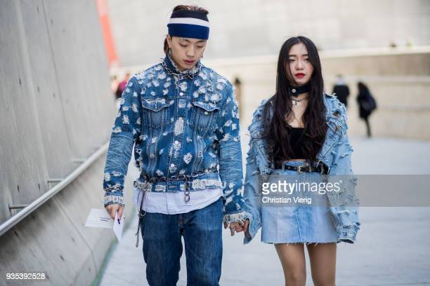 A couple wearing denim jacket jeans and skirt is seen at the Hera Seoul Fashion Week 2018 F/W at Dongdaemun Design Plaza on March 20 2018 in Seoul...