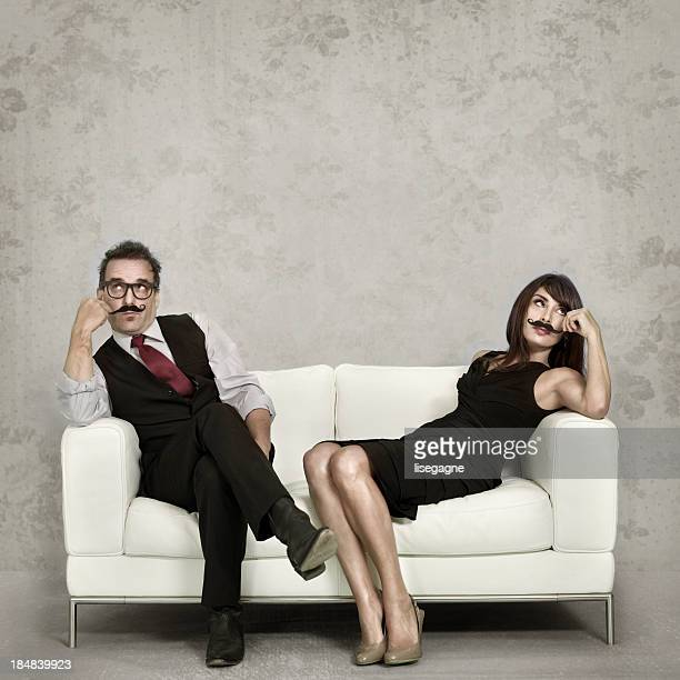 Couple wearing fake mustaches