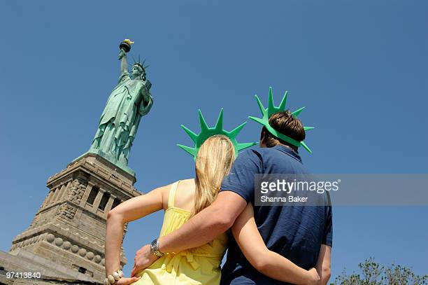 Couple wearing foam crowns at Statue of Liberty