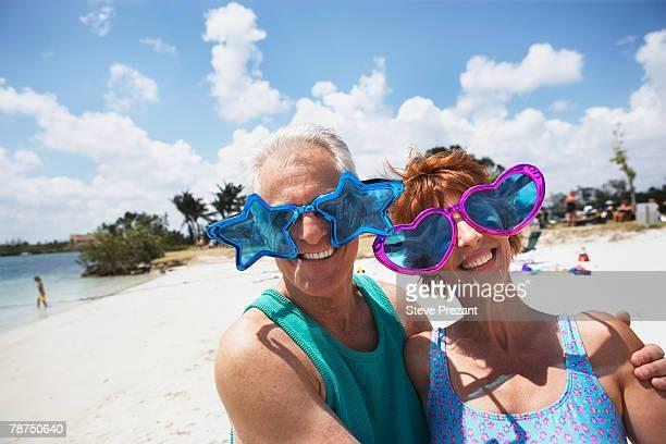 Couple Wearing Goofy Sunglasses on Beach