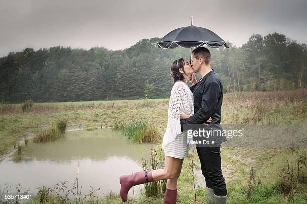 Couple wearing gumboots in the rain