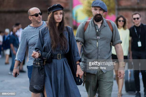 A couple wearing is seen during Pitti Immagine Uomo 92 at Fortezza Da Basso on June 15 2017 in Florence Italy