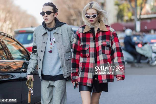 A couple wearing lumberjack jacket outside Armani during Milan Fashion Week Fall/Winter 2017/18 on February 27 2017 in Milan Italy