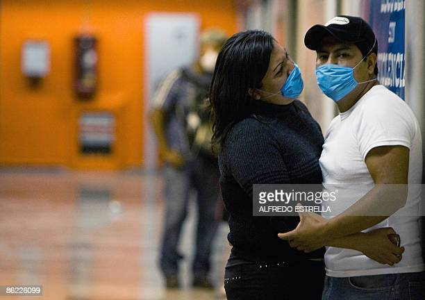 A couple wearing masks waits for the subway at the Pino Suarez station in Mexico City on April 26 2009 As a preventive measure against contagion of...