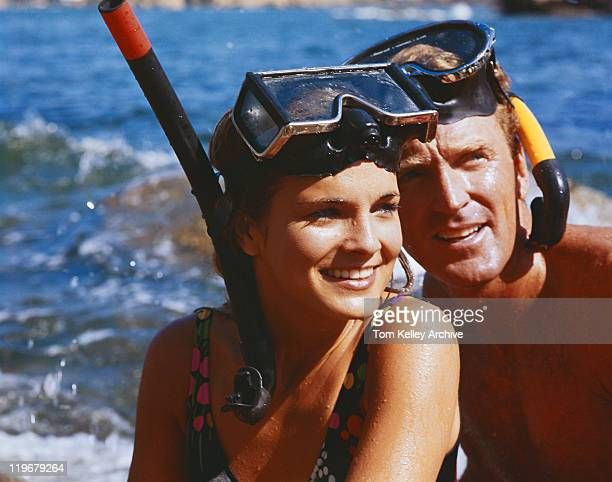couple wearing snorkel, smiling, close-up - 1976 stock pictures, royalty-free photos & images
