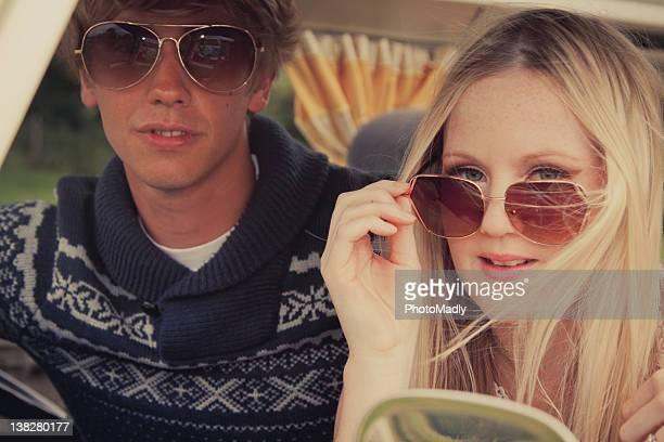 Couple wearing sunglasses in camper van