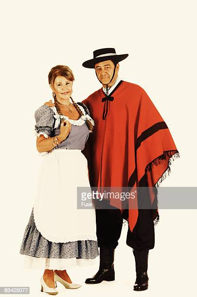 couple wearing traditional clothing - argentina traditional clothing stock photos and pictures
