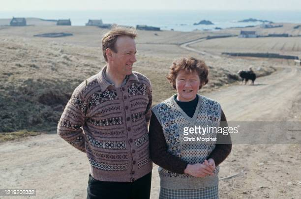 Couple wearing traditional Fair Isle pattern knitwear, Fair Isle, Shetland Islands, Scotland, June 1970.