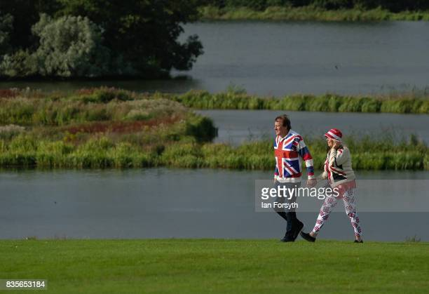 A couple wearing Union Flag themed clothing arrive for the start of the annual Castle Howard Proms Spectacular concert held on the grounds of the...