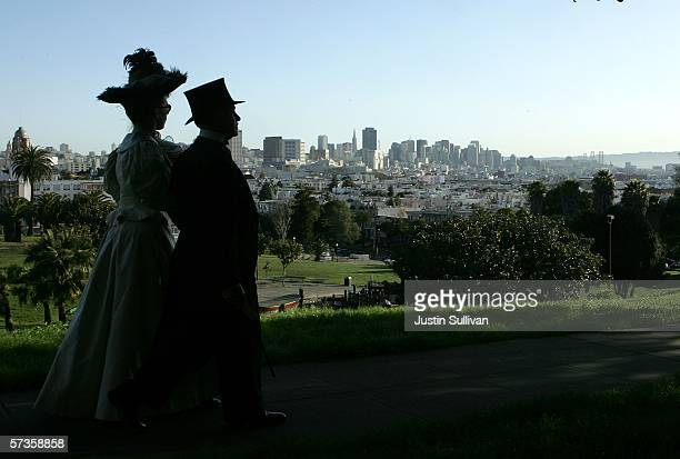 A couple wearing vintage clothing walk in Dolores Park after the annual painting of the fire hydrant known as the 'little giant' on April 18 2006 in...
