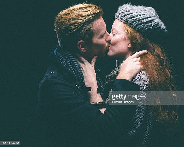 couple wearing warm clothing kissing - couple hot kiss stock photos and pictures