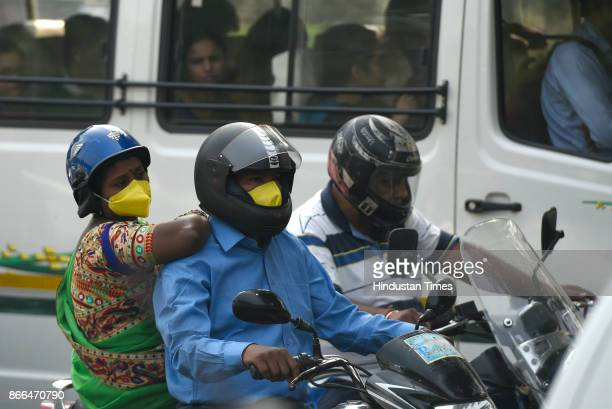 Couple wears masks during a clean air campaign on the occasion of World Sustainability Day on October 25 2017 in New Delhi India