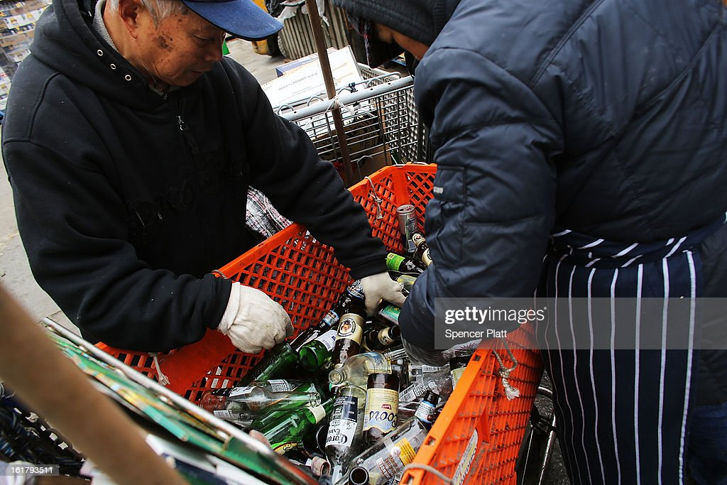 A couple who make their living by collecting bottles and cans or 'canning' for short, sort through an evenings collection at Sure We Can, a non-profit bottle redemption center in Bushwick, Brooklyn that is pushing to become a cooperative for the canning community on February 16, 2013 in New York City. Sure We Can, which was partly started by homeless canners in 2007 and is run by one of its founders Sister Ana Martinez de Luco, looks to give the diverse members of the canning community a safe and fraternal place to redeem cans, store their carriages and become members of an association that encourages self-dependence and responsibility. Many of New York's canners are non-English-speaking elderly immigrants who live a marginalized existence and are vulnerable to dishonest business practices. Sure We Can currently serves around 50 canners per day and recycles over 6 million bottles and cans per year.