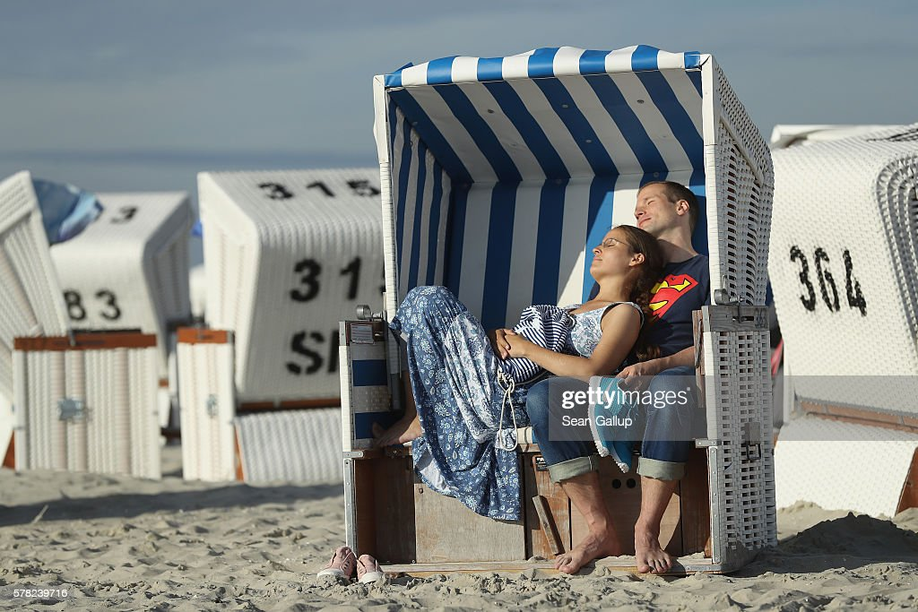 A couple, who said they did not mind being photographed, relax in a beach chair at the beach on July 18, 2016 at Sankt-Peter-Ording, Germany. Sankt-Peter-Ording is among the top destinations for vacationers along Germany's North Sea coast. Many Germans, unsettled by the recent terror attacks in countries like France and Turkey, are choosing to vacation in Germany this summer.