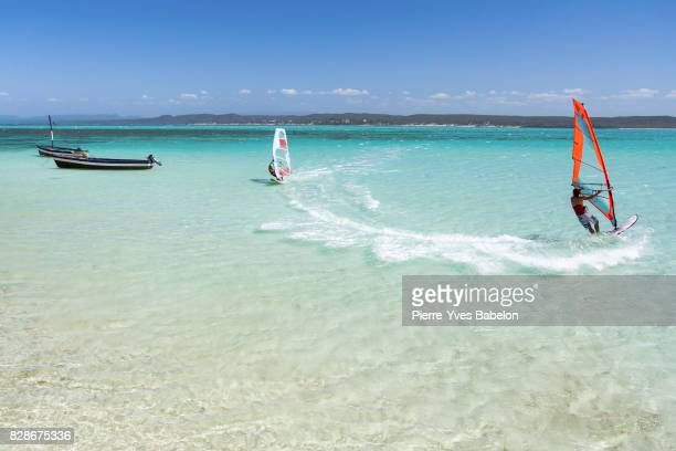 couple windsurfers - windsurfing stock pictures, royalty-free photos & images