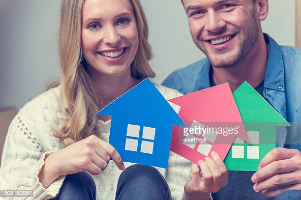 Couple with 3 house symbols – choice concept.