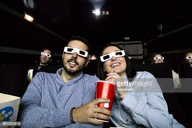 Couple with 3d glasses watching a movie in a cinema