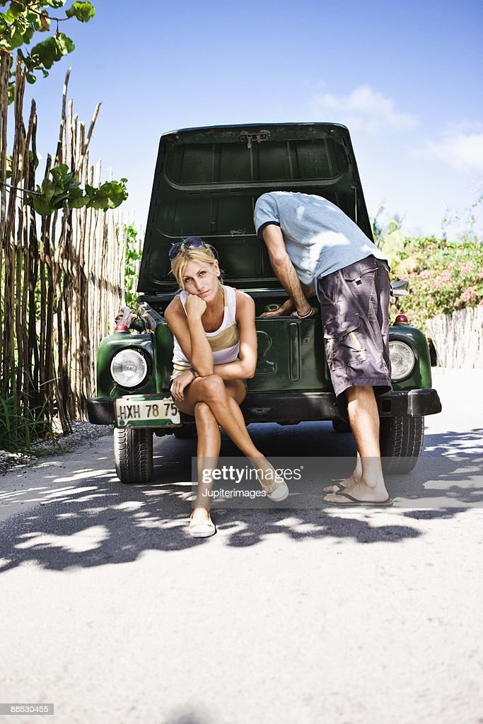 With A Broken Down Car Stock Photo Getty Images