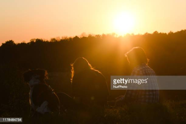 A couple with a dog enjoys a sunset view in Zakrzowek Park area of Krakow The South of Poland including the town of Krakow experianced a few days of...