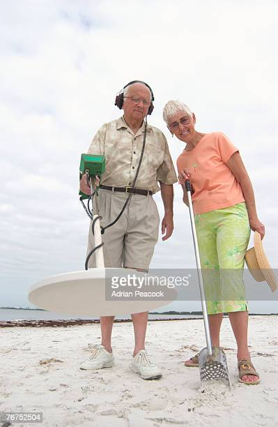Couple with a metal detector