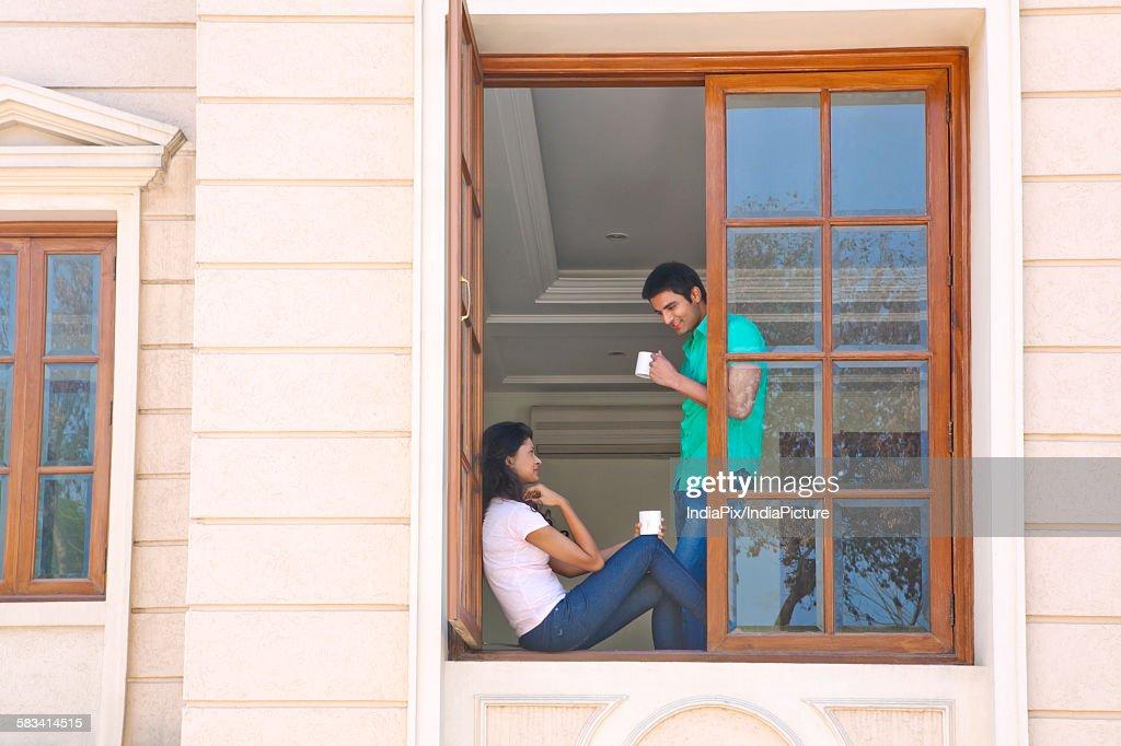 Couple with a mug of tea : Stock Photo